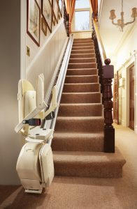 Folded stairlift at the bottom of a staircase